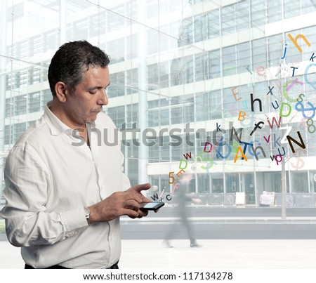 Businessman writing with touch screen phone - stock photo