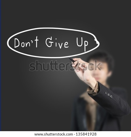 Businessman writing word don't give up
