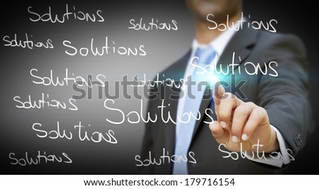 Businessman writing words on digital interface - stock photo