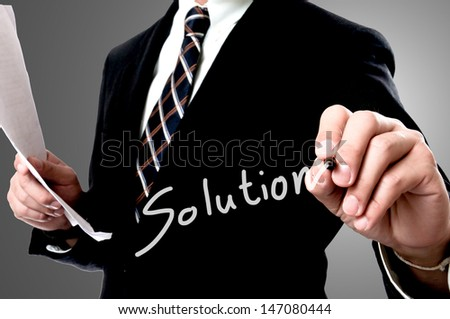 Businessman wrote solution concept  - stock photo