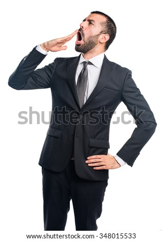 Businessman yawning