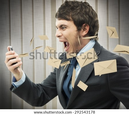 Businessman yelling for too many email received - stock photo