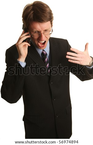 businessman yelling into the mobile phone