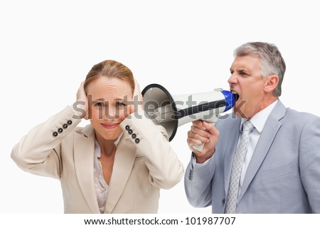 Businessman yelling with a megaphone after his colleague against white background