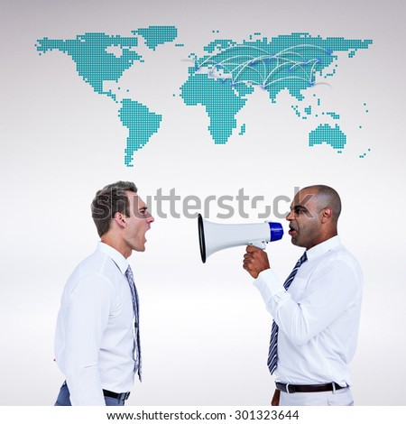 Businessman yelling with a megaphone at his colleague against world map - stock photo