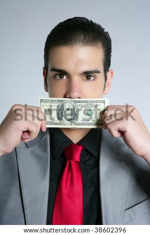 Businessman young with dollar notes suit and tie on gray background - stock photo