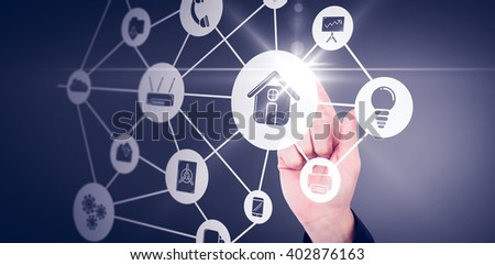 Businessmans hand pointing in suit jacket against smartphone apps icons