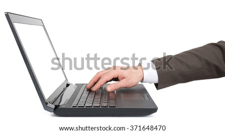 Businessmans hand working on laptop