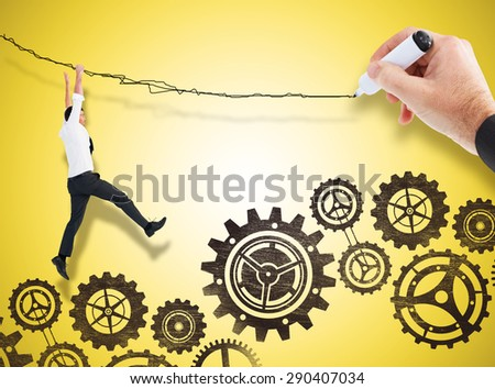 Businessmans hand writing with marker against yellow vignette - stock photo