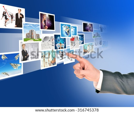 Businessmans handwith holographic pictures on abstract background