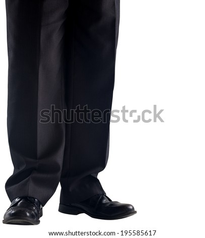 Businessmans legs and dress shoes on white background