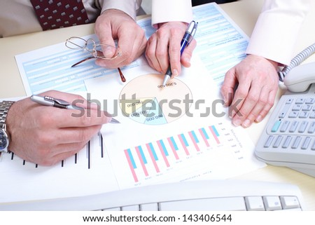 Businessmans working with documents in the office