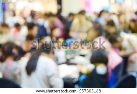 Businessmen and women blur in work conference