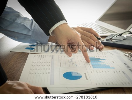 Businessmen are analyzing market data to clients or partners have been informed. - stock photo