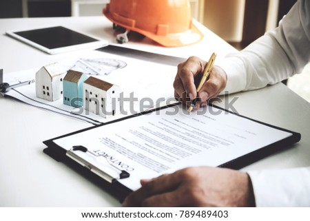 Broker blueprint stock images royalty free images vectors businessmen are checking the contract to use the right pen signed building approval with blueprint malvernweather Gallery