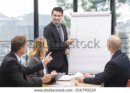 Businessmen are meeting near the flipchart