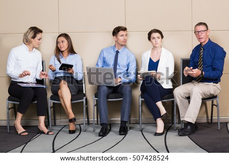 Businessmen Businesswomen Sitting and Waiting