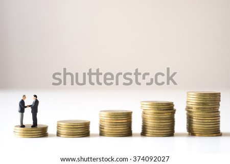 Businessmen checking hand on first step of coin stack stair, Successive business concept.