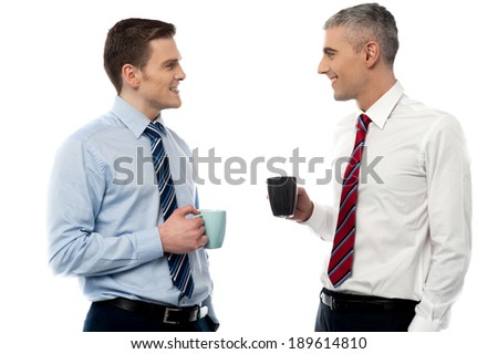 Businessmen discussing business over a mug of coffee - stock photo