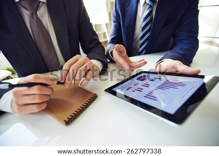 Businessmen discussing working moments. - stock photo