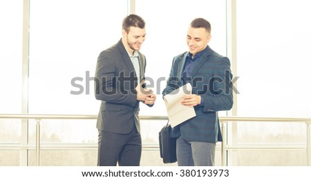 businessmen discussion with notes