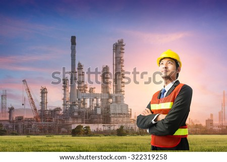 Businessmen engineering standing handsome smile in front of oil refinery industry - stock photo