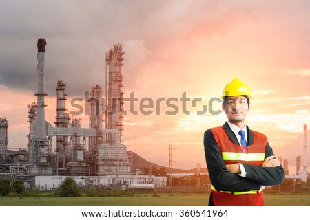Businessmen engineering standing handsome smile in front of oil refinery industry
