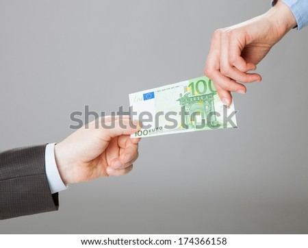Businessmen exchanging euro banknote - stock photo