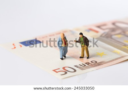 businessmen figurines standing on euro banknotes, financial deal concept,on white background - stock photo