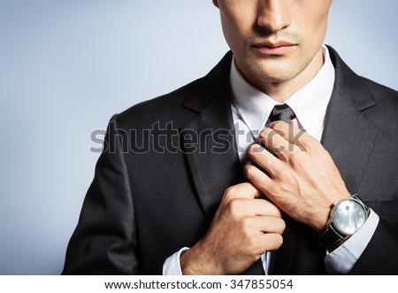 Businessmen fixing his suit. - stock photo