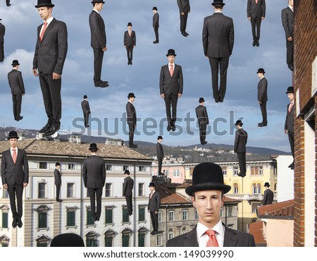businessmen floating in the sky over european city, magritte style - stock photo