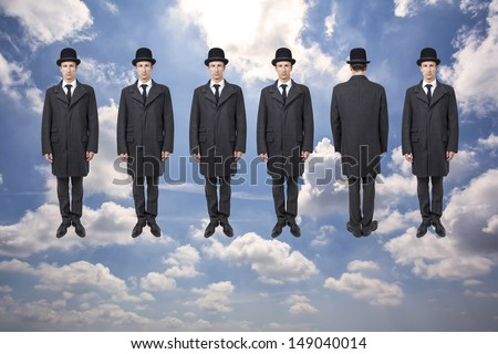 businessmen floating over blue sky with clouds, magritte style - stock photo