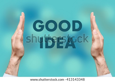 """Businessmen from both hands """" GOOD IDEA """" writes - stock photo"""