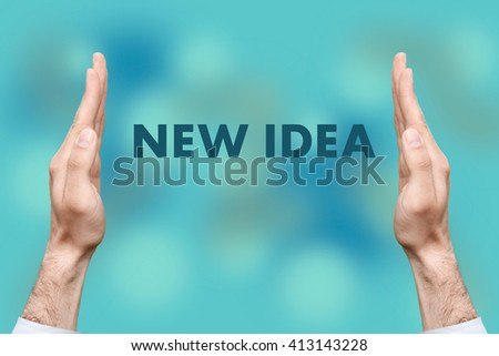 """Businessmen from both hands """" NEW IDEA """" writes - stock photo"""