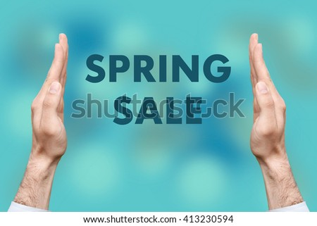 "Businessmen from both hands "" SPRING SALE "" writes - stock photo"