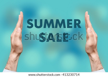 "Businessmen from both hands "" SUMMER SALE "" writes - stock photo"