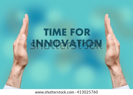 """Businessmen from both hands """" Time For Innovation """" writes - stock photo"""