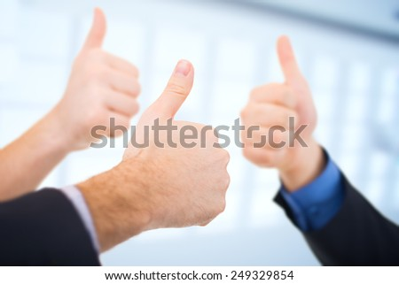 Businessmen gesturing thumbs up. Business concept. - stock photo