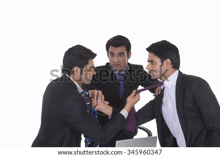 Businessmen getting into a fight