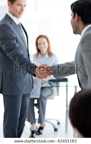 Businessmen greeting each other at a job interview in an office - stock photo