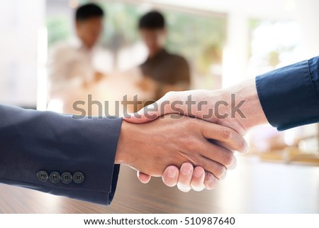 Businessmen handshake and business people ; success, dealing, greeting & business partner concepts.