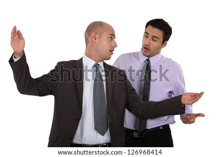 Businessmen having a disagreement - stock photo