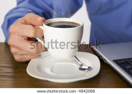 businessmen holding cup of hot coffee close up - stock photo