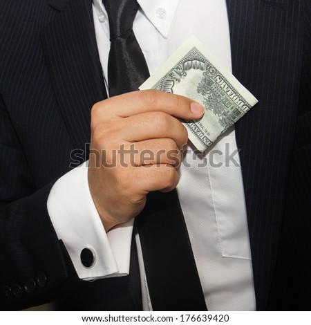 Businessmen holding money 100 dollars  - stock photo
