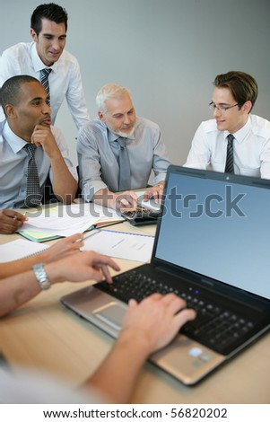 Businessmen in a meeting with a laptop computer
