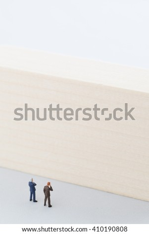 Businessmen in confrontation with difficulty - stock photo