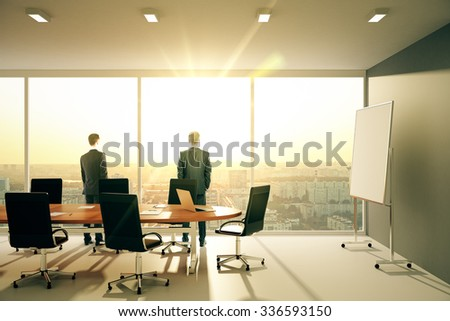 Businessmen in sunny conference room with furniture and cityview 3D Render - stock photo