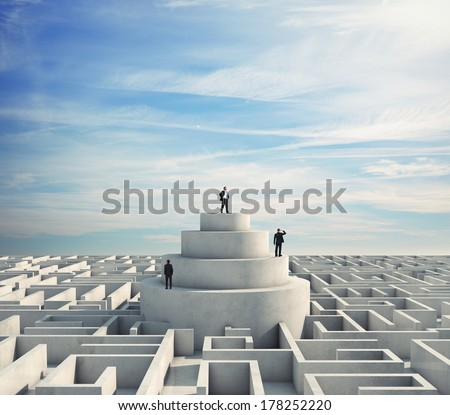 Businessmen in the middle of a labyrinth - stock photo