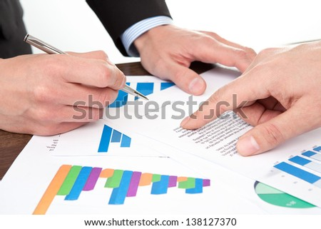 businessmen in the office signing documents - stock photo