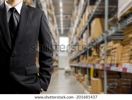 Businessmen In Warehouse preparing goodsfor dispatch